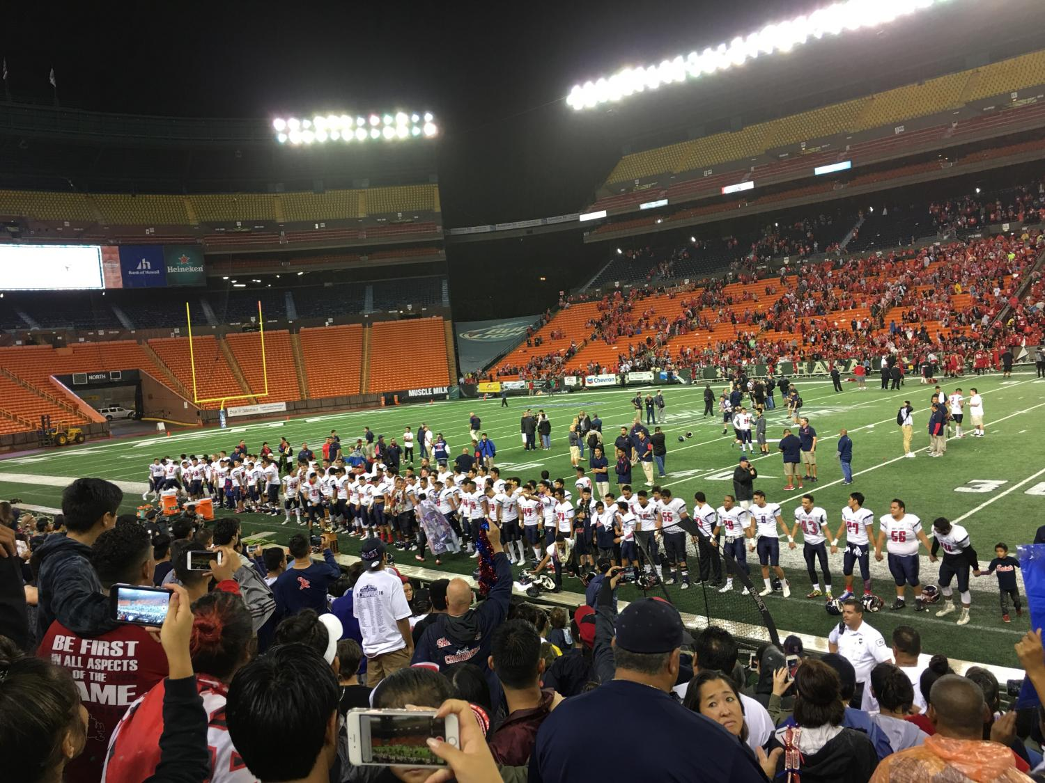 Excited Crusader fans watch as their team sings the alma mater, after defeating Kahuku for the first ever Open Division Championship. Photo by Chord Medeiros