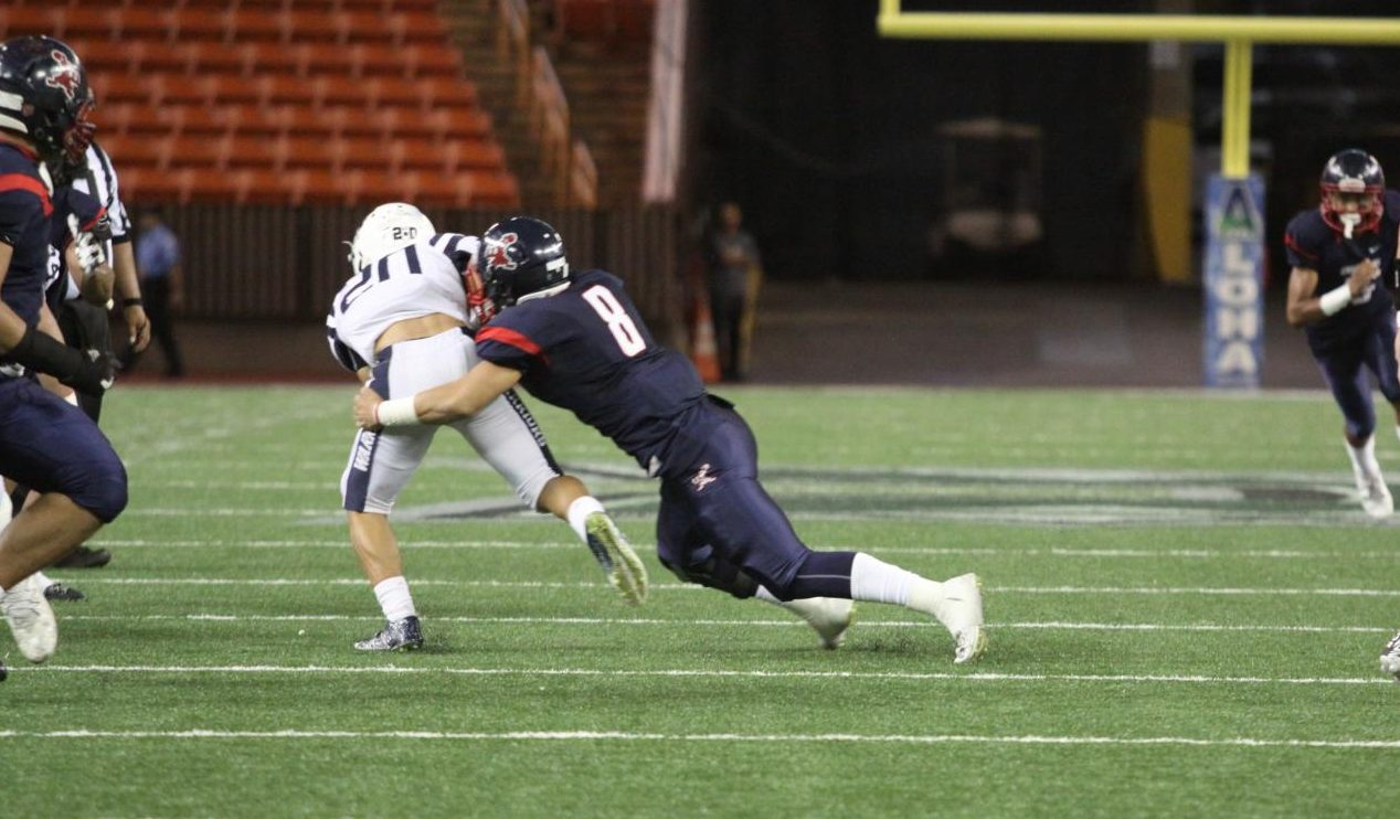 Isaiah Taliulu takes down Kamehameha's running back for a loss.
