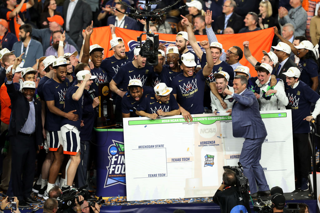 MINNEAPOLIS, MINNESOTA - APRIL 08: The Virginia Cavaliers celebrate their National Championship after defeating the Texas Tech Red Raiders in the 2019 NCAA men's Final Four National Championship game at U.S. Bank Stadium on April 08, 2019 in Minneapolis, Minnesota. (Photo by Matt Marriott/NCAA Photos via Getty Images)