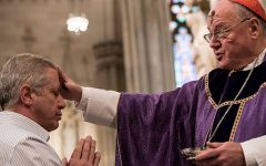 NEW YORK, NY - FEBRUARY 10:  Cardinal Timothy Dolan distributes ashes on Ash Wednesday at St. Patrick's Cathedral on February 10, 2016 in New York City. The day marks the start of the lent for Catholics world wide.  (Photo by Andrew Renneisen/Getty Images)
