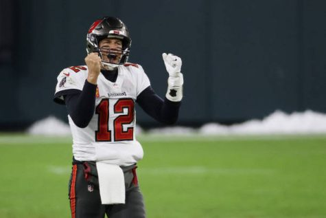 GREEN BAY, WISCONSIN - JANUARY 24: Tom Brady #12 of the Tampa Bay Buccaneers celebrates in the final seconds of their 31 to 26 win over the Green Bay Packers during the NFC Championship game at Lambeau Field on January 24, 2021 in Green Bay, Wisconsin. (Photo by Dylan Buell/Getty Images)