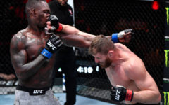 LAS VEGAS, NEVADA - MARCH 06: (R-L) Jan Blachowicz of Poland punches Israel Adesanya of Nigeria in their UFC light heavyweight championship fight during the UFC 259 event at UFC APEX on March 06, 2021 in Las Vegas, Nevada. (Photo by Jeff Bottari/Zuffa LLC)